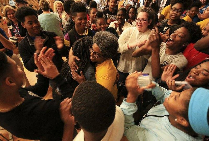 On stage in the auditorium of Little Rock Central High School being embraced by my AVID students & Writeous Poets shortly after being named 2019 Arkansas Teacher of the Year.